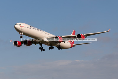 """Virgin Atlantic's """"Scarlet Lady"""", an Airbus A340-642 approaches Sydney airport's runway 16 right for landing. This plane was the first in the fleet to wear this iteration of the Virgin Atlantic colour scheme."""