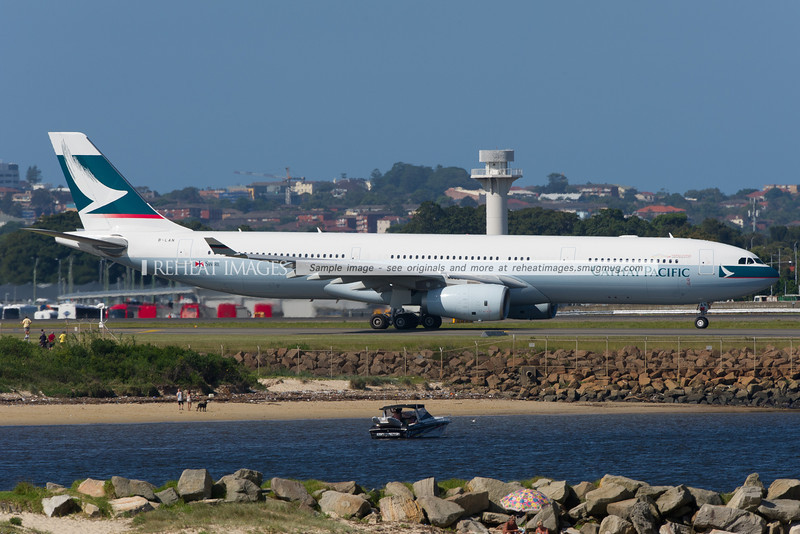 Cathay Pacific's newest A330-300 Airbus (at the time of writing) B-LAN heads out to runway 34 left at Sydney airport.