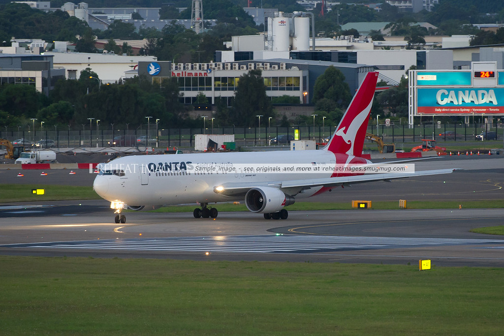 Qantas B767-338/ER is turning on to runway 16 right at Sydney airport.