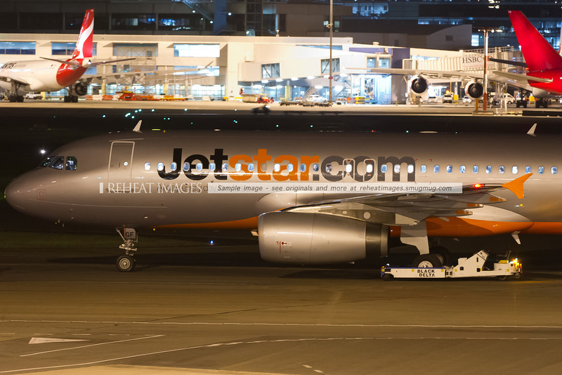 A Jetstar Airbus A320-200 has been pushed back from the terminal.