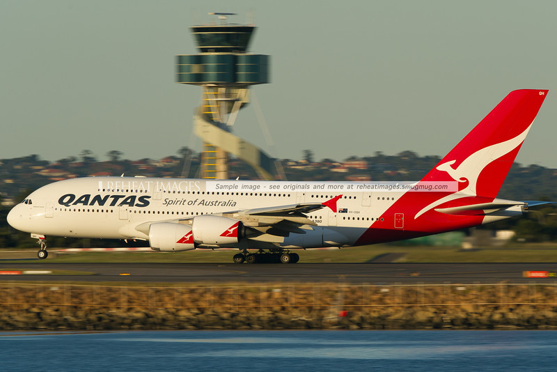 Qantas Airbus A380-842 Reginald Ansett (VH-OQH) takes off from Sydney airport in late afternoon sunlight.