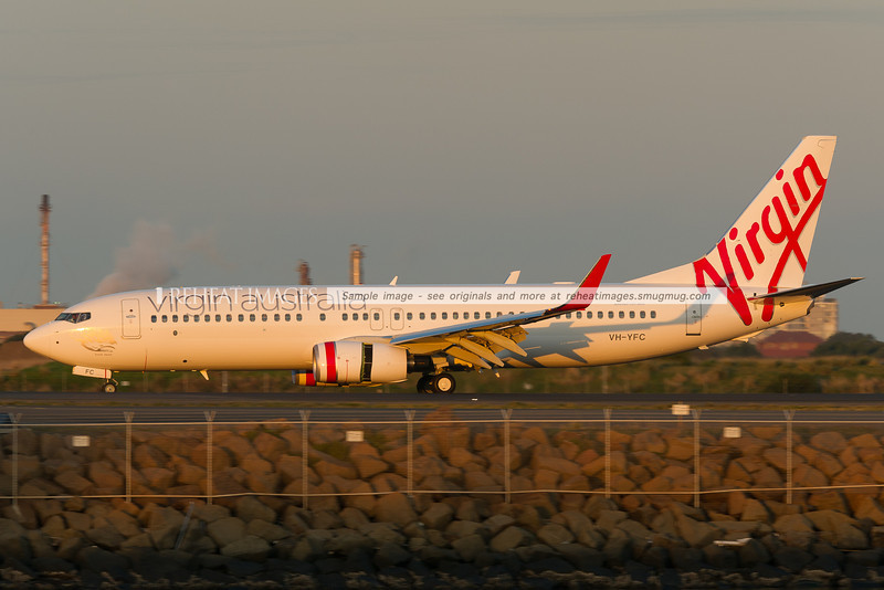 A new Virgin Australia Boeing 737-81D lands at Sydney airport.