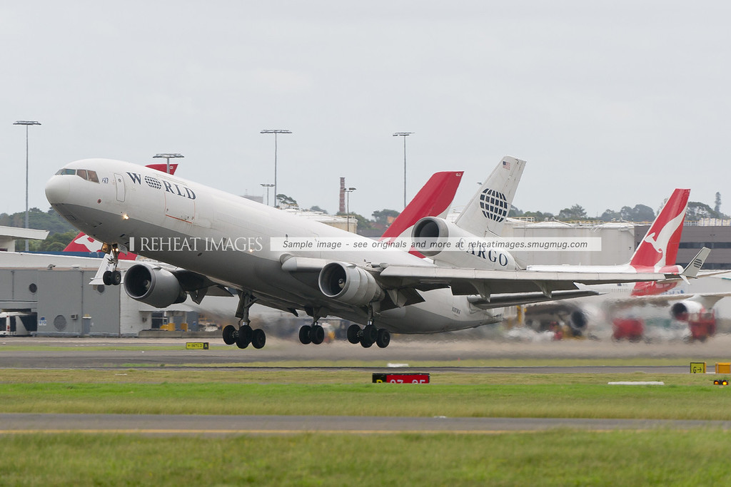 Etihad 9877 leaving Sydney in spectacular fashion is operated by this World Airways McDonnell-Douglas MD-11F.