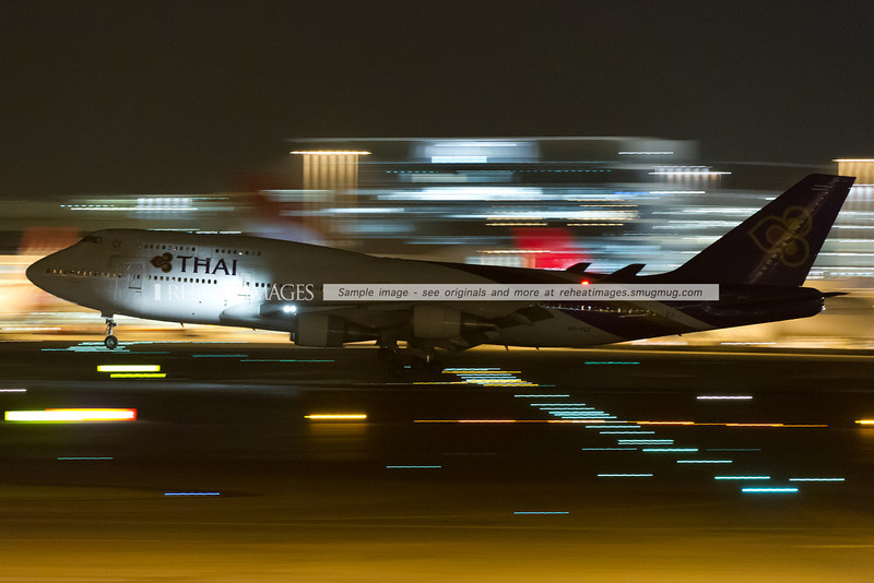 Thai Boeing 747-400 arrives in Sydney at night.
