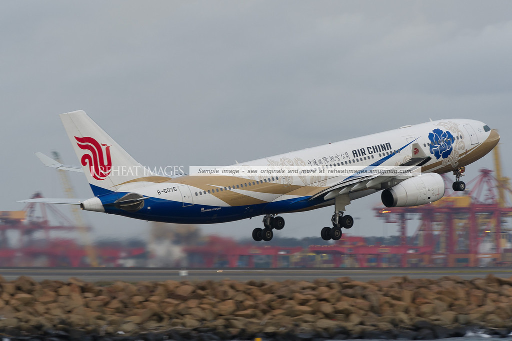 China Airlines A330 with an eye-catching blue Capital Pavillion colour scheme was running late on this grey and rainy day.