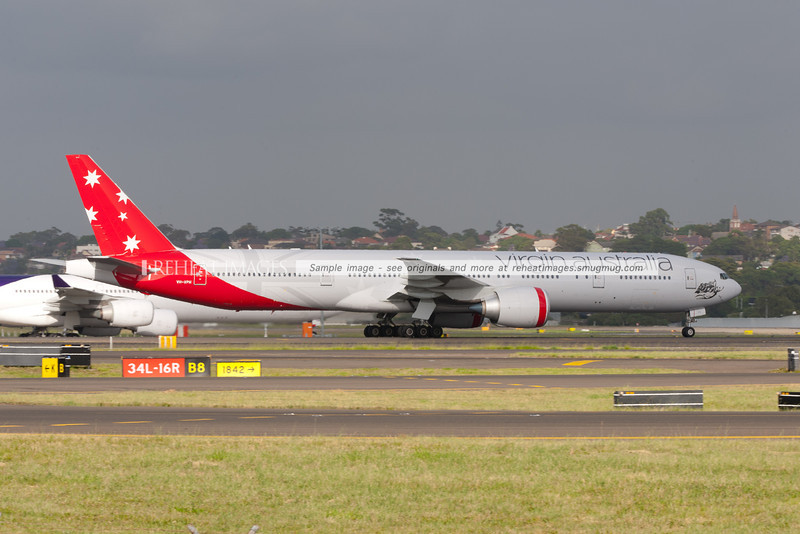 The former V. Australia B777-3ZG/ER now wears partially new identification as Virgin Australia and with the new motif at the front, while the rest is the traditional V.Australia colours.