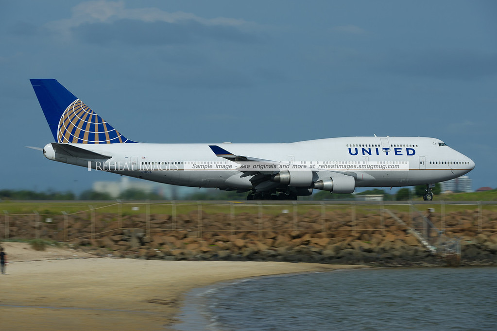 A United Boeing 747-422 takes off from Sydney airport. This plane wears the new colour scheme.