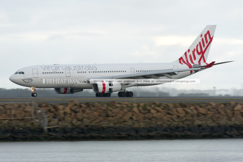 Virgin Australia Airbus A330 lands at Sydney airport in poor weather conditions.