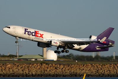 A FedEx McDonnell-Douglas MD-11F aircraft takes off from runway 34 left at Sydney airport.