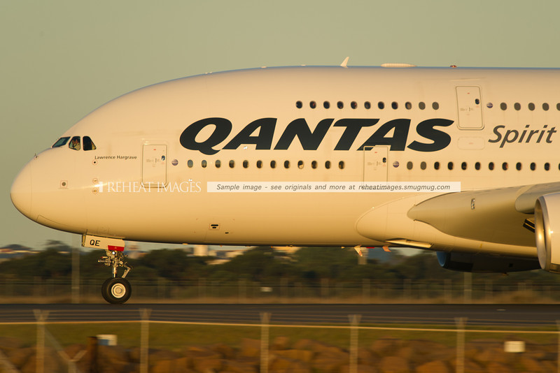 A close up view of a Qantas Airbus A380-842 departing Sydney airport on runway 34L.