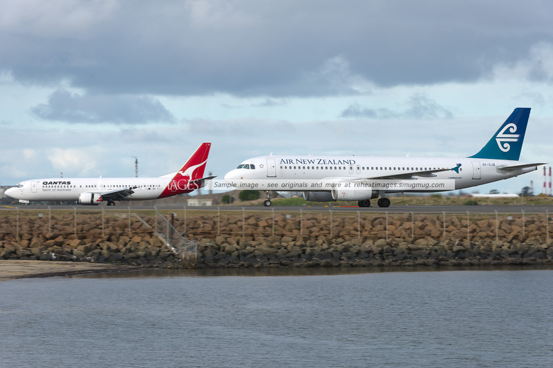 Air New Zealand Airbus A320 and Qantas B737-400 at Sydney airport.