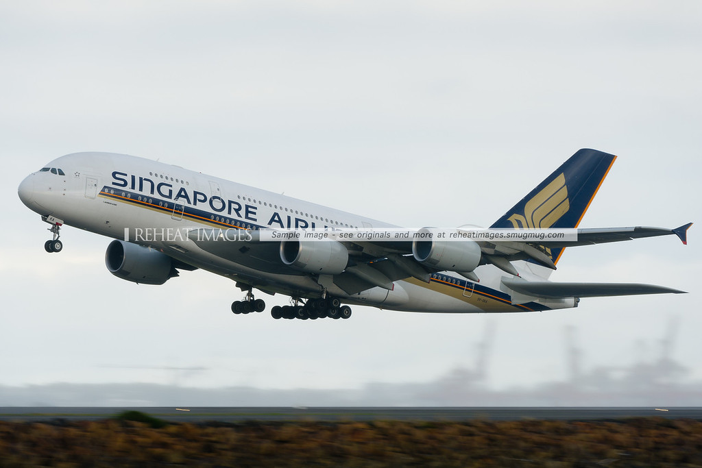 This particular Airbus A380, registered 9V-SKA was the first ever A380 to enter commercial service, on a flight from Singapore to Sydney and was piloted by Singapore Airlines' Captain Robert Ting on that special occasion. Here, it seen taking off very early from runway 34 left at Sydney airport, shrouded in rain and mist during passing rain showers.