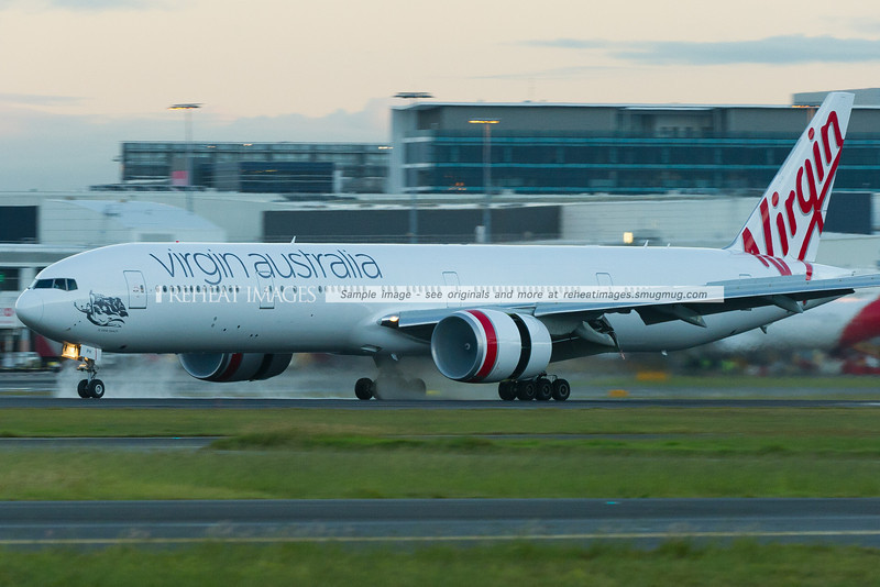 Virgin Australia's newly repainted B777-3ZG/ER VH-VPH arrives home from Abu Dhabi as VA30. It is named St Kilda Beach. Some rain overnight left standing water on the runway, which the large GE90-115B engines throw up with their reverse thrust.
