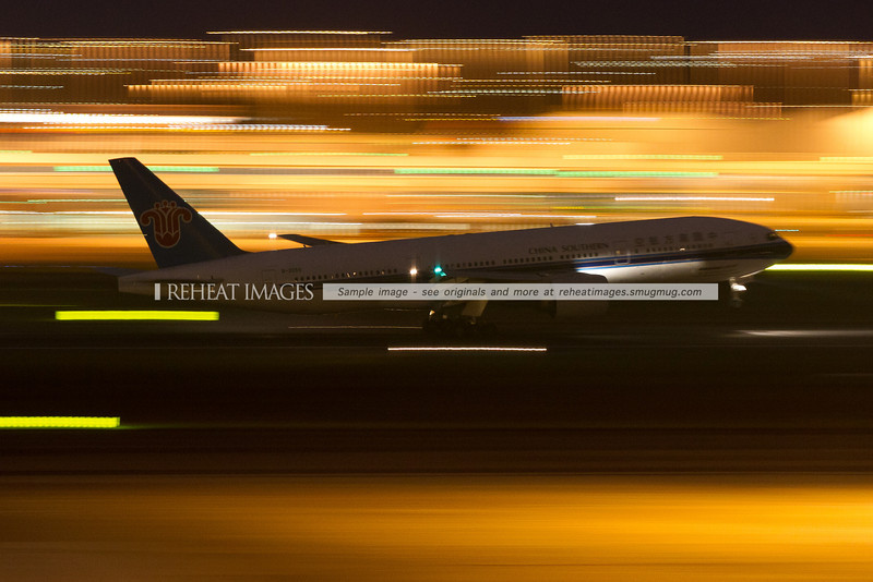 China Southern B777 lands at Sydney airport at night.