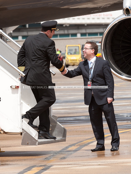 John Travolta shakes hands with Qantas' Alan Joyce at the Qantas 90th anniversary celebrations in Sydney.