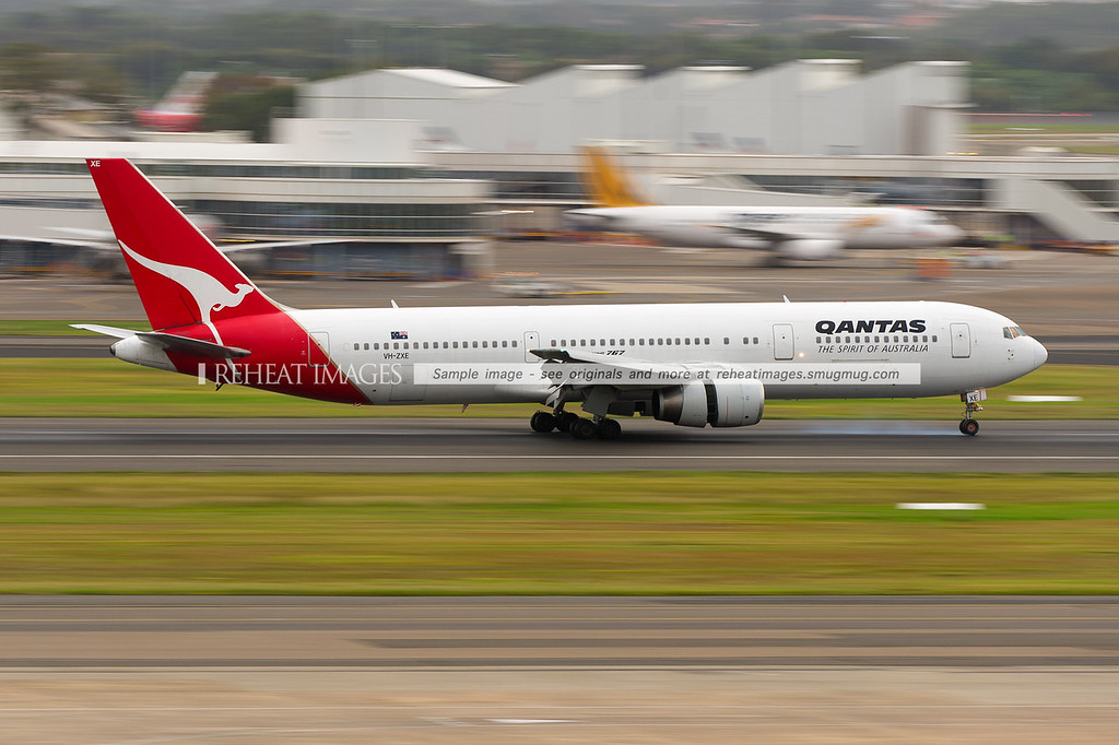 A Qantas Boeing 767-336/ER VH-ZXE arrives at Sydney airport on runway 16 right.