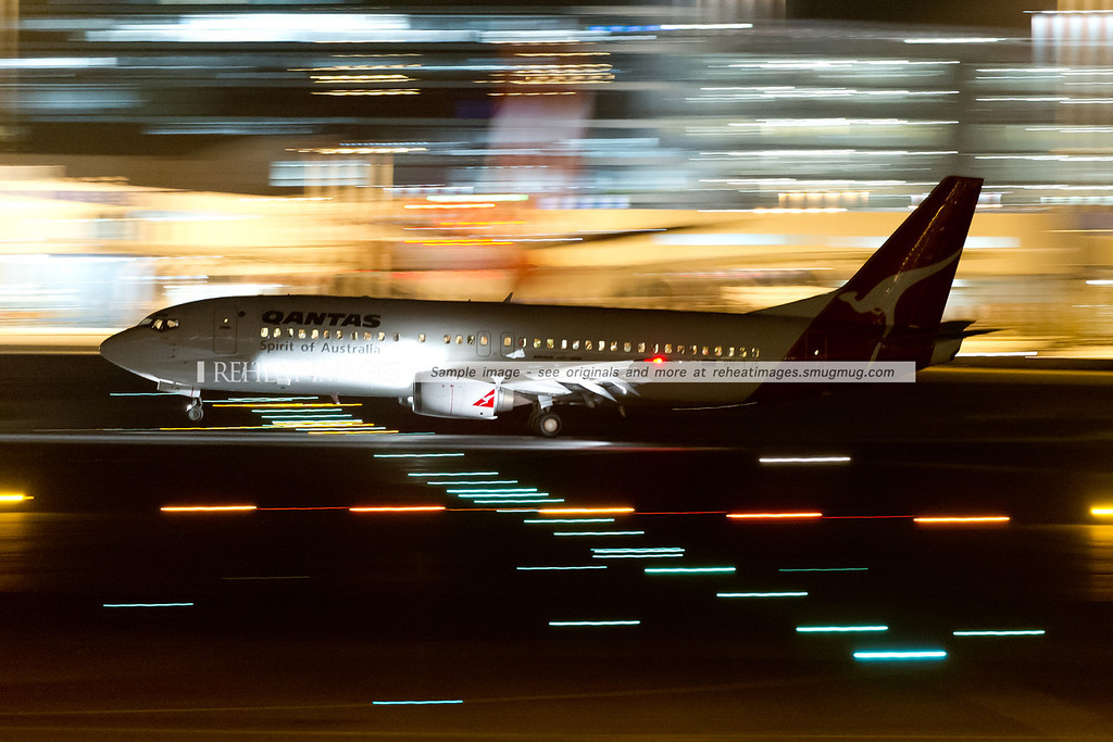 Qantas B737-400 arrives in Sydney. Low shutter speed and the high speed of the plane contributes to the motion bluring of the background.