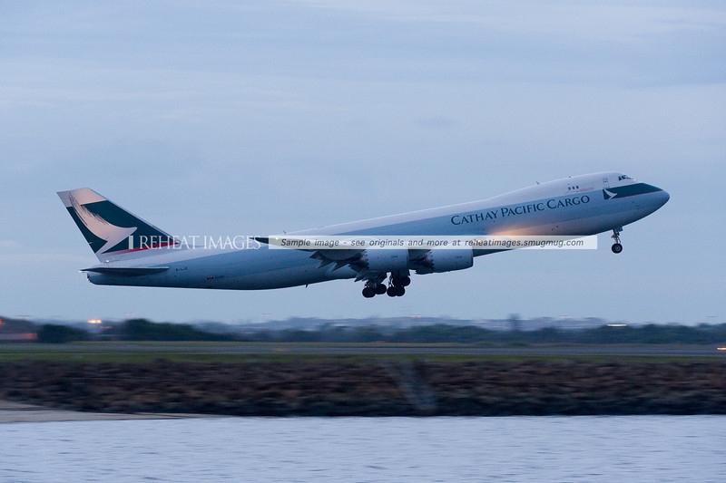 Cathay Pacific B747-867F B-LJE takes off from Sydney Airport operating flight CX024.