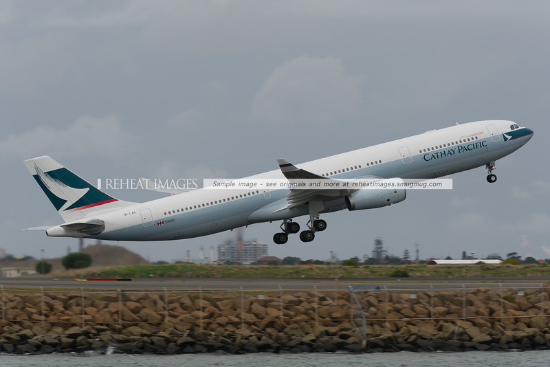 Cathay Pacific's Airbus A330-300 registered B-LAL takes off from Sydney Airport.