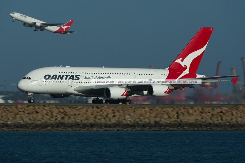 """Reginald Ansett"" departs Sydney as QF31. The plane briefly wore new titles ""Spirit of Australians"", though they were removed before this photo was taken. In the background, a company Boeing 767-338/ER departs from runway 34 right."