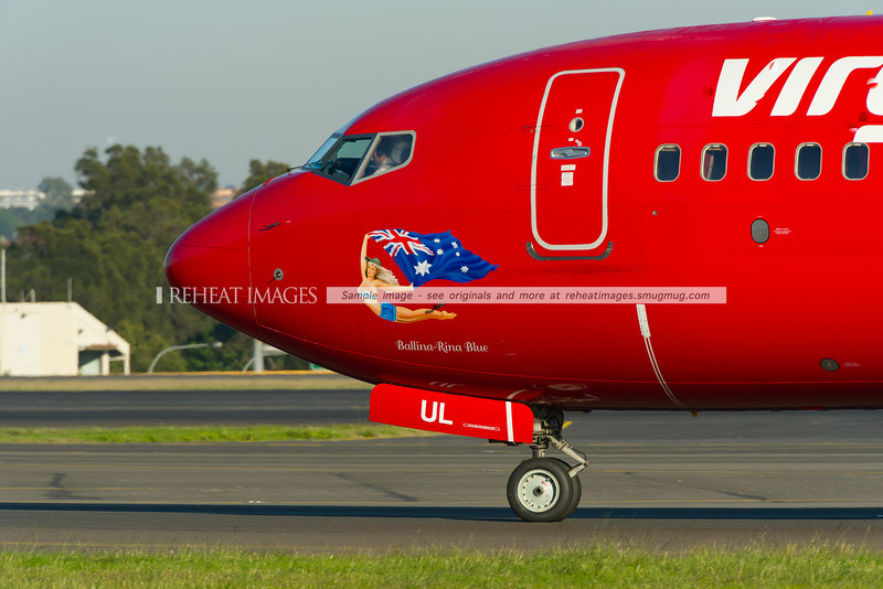 A Virgin Blue (Virgin Australia) Boeing 737-800 at Sydney airport. This one is called Ballina-Rina Blue