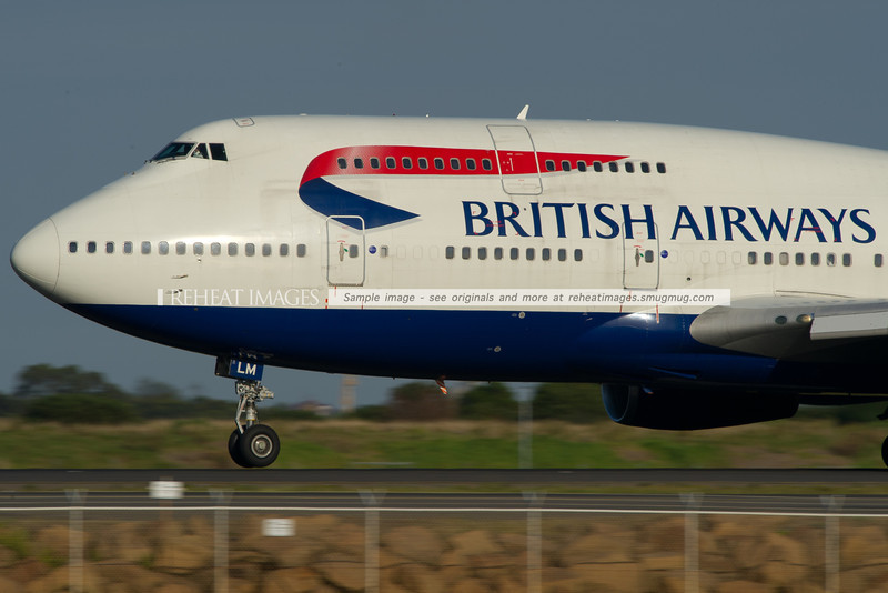 A British Airways B747-436 begins to lift off runway 34 left at Sydney airport. The nose wheel has just lifted off the ground and the plane will shortly be airborne.