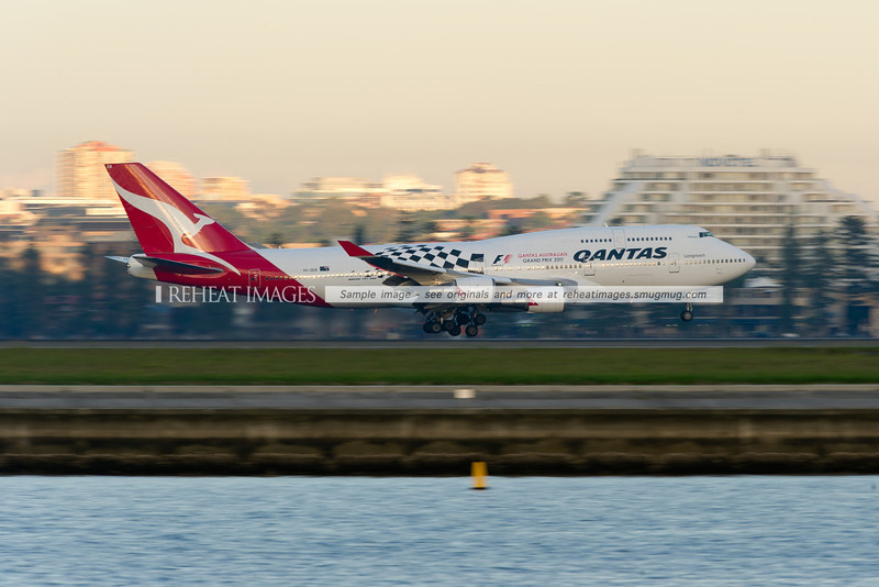 The special coloured Qantas Boeing 747-48E promotes the 2011 Qantas Australian Grand Prix. It is seen landing at Sydney airport runway 34 left.