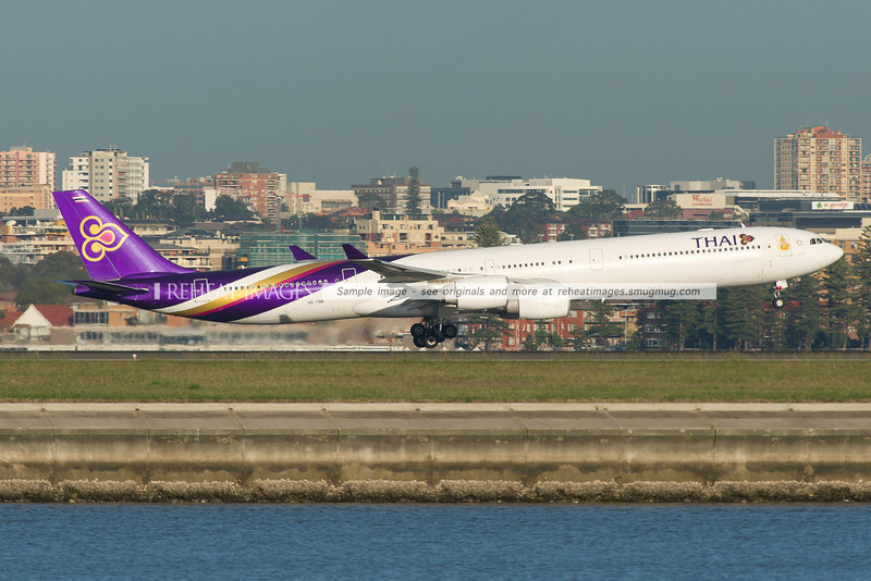 Thai A340-642 is landing at Sydney airport runway 34 left against the backdrop of Brighton-Le-Sands.