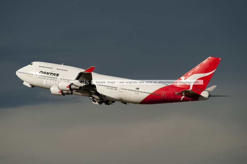 A Qantas Boeing 747-4H6 takes off from Sydney airport. The planes VH-OEC and VH-OED were acquired from Malaysia Airlines. They have since been sold by the airline.