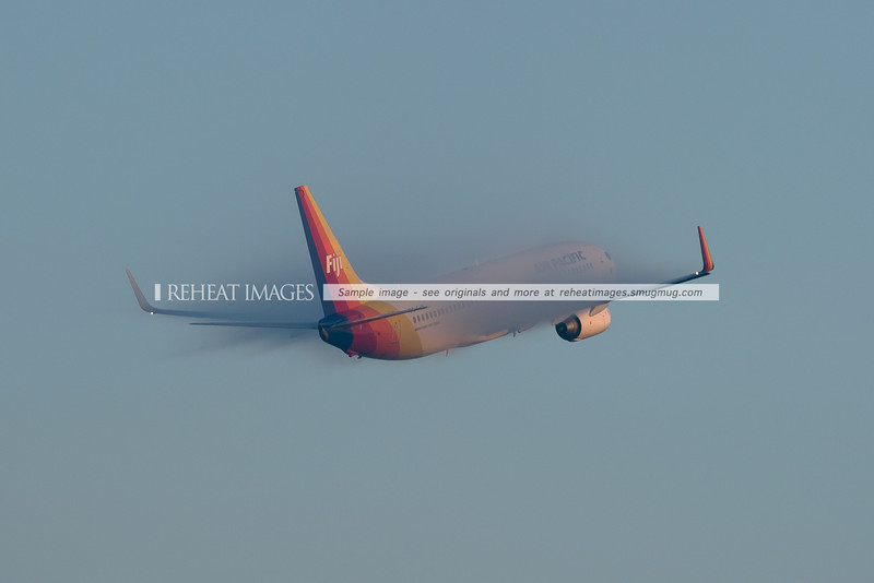 Air Pacific B737-800 takes off in heavy fog at Sydney airport.