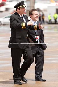 John Travolta and Qantas' Alan Joyce at the Qantas 90th anniversary celebrations in Sydney. Mr Travolta gives the thumbs up!