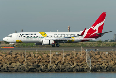 Qantas (JetConnect) B737-800 lands at Sydney airport. It is carrying a special colour scheme supporting the Australia rugby team.