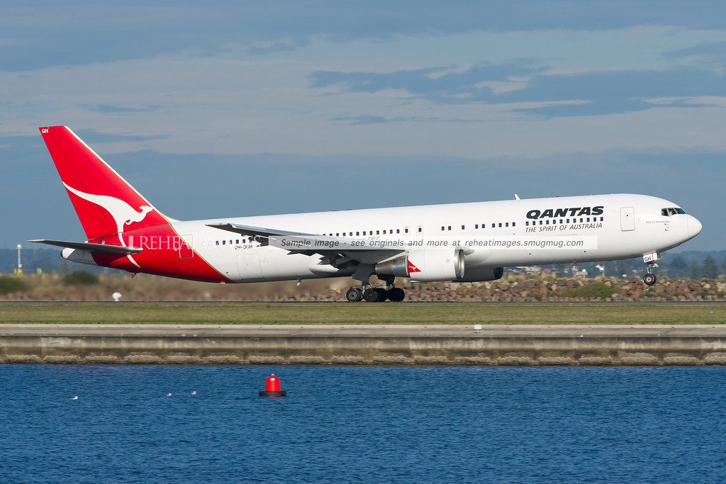 "A Qantas Boeing 767-338/ER VH-OGH ""City of Parramatta"" departs Sydney airport on runway 34 right."