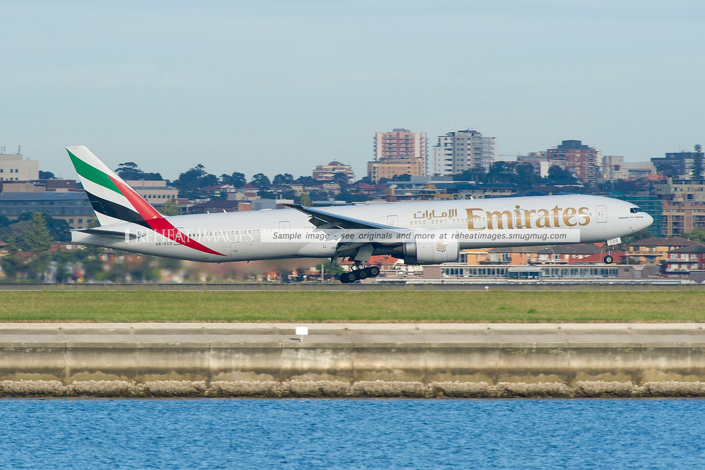 Emirates Boeing 777-300/ER is landing at Sydney airport runway 34 left against the backdrop of Brighton-Le-Sands.