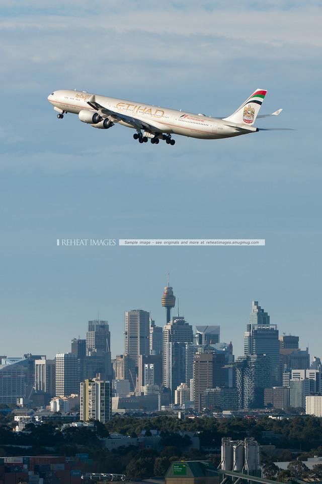 Etihad Airbus A340-642 A6-EHI departs Sydney