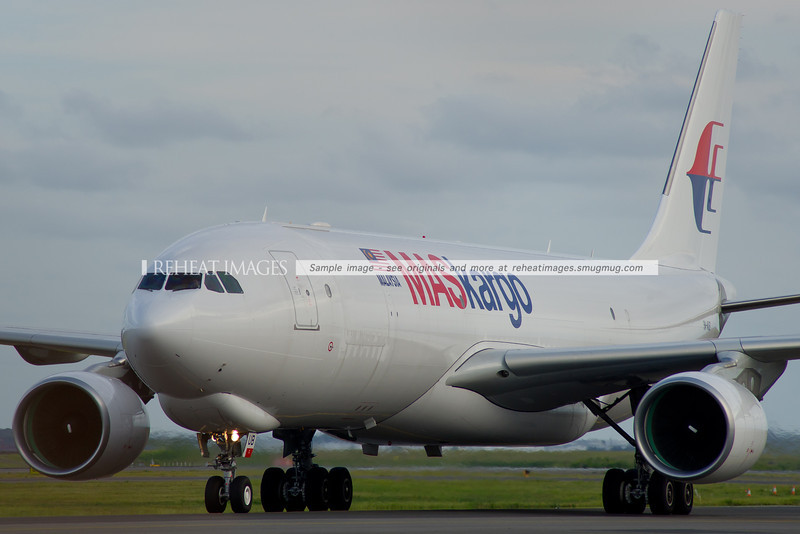 A MASkargo Airbus A330-200F arrives in Sydney airport at dusk.
