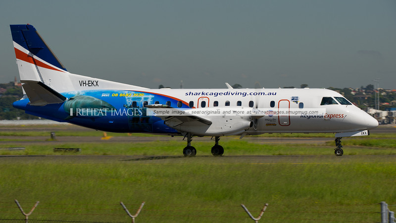 Regional Express SAAB 340 arrives in Sydney. The aircraft  carries advertising for Shark Cage tourism.