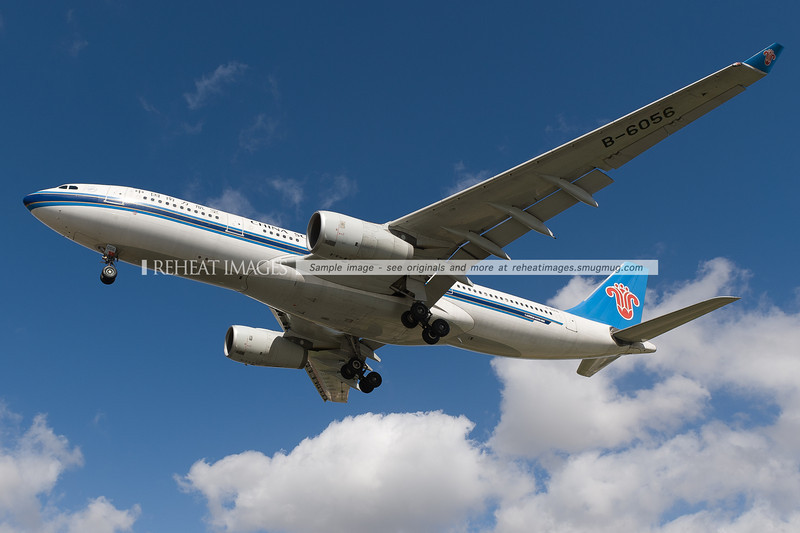China Southern Airbus A330 lands at Sydney airport. It is seen here passing very low over Qantas Drive.