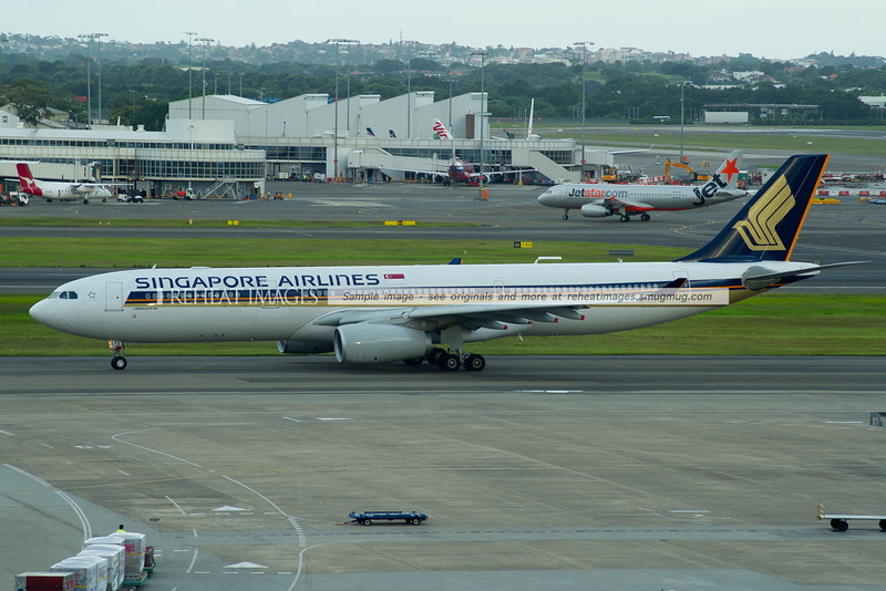 Singapore Airlines A330-300 9V-STS taxis out to runway 16 right. The plane is operating flight SQ242.