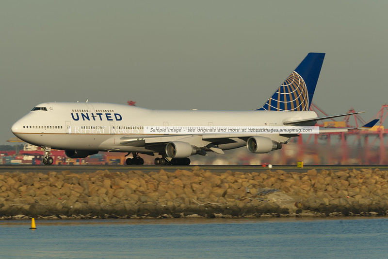 This United B747-422 N127UA suffered a mechanical issue - so stayed overnight in Sydney. It is seen here departing for San Francisco as UA1751. This is one of the B747 aircraft in the new colour scheme of the merged United/Continental airline.