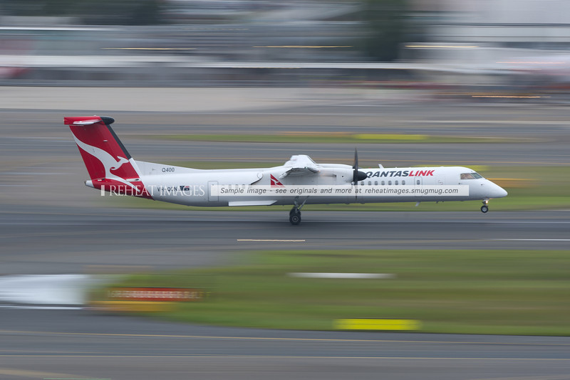 A Bombardier Dash-8 Q400 of QantasLink arrives at Sydney airport.