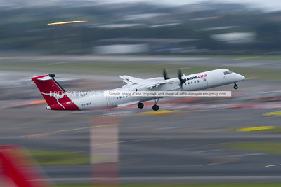 A Bombardier Dash-8 Q400 of QantasLink takes off from Sydney airport in gusty conditions.