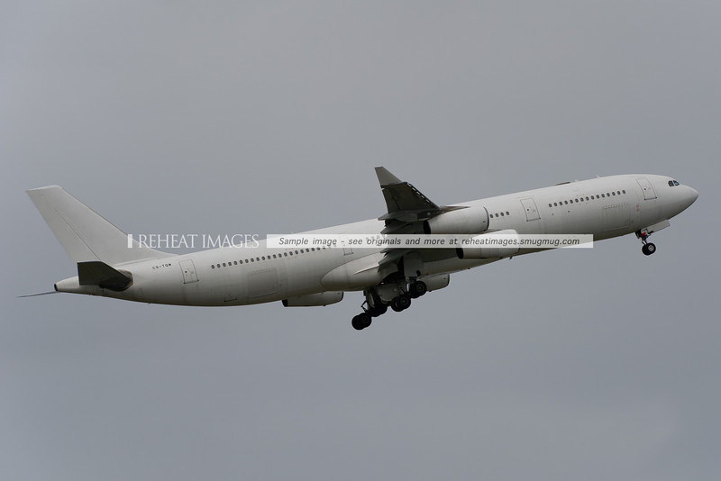 Adagold Aviation (HiFly) A340-300 taking off from Sydney airport, operating for the Australian Defence Force.