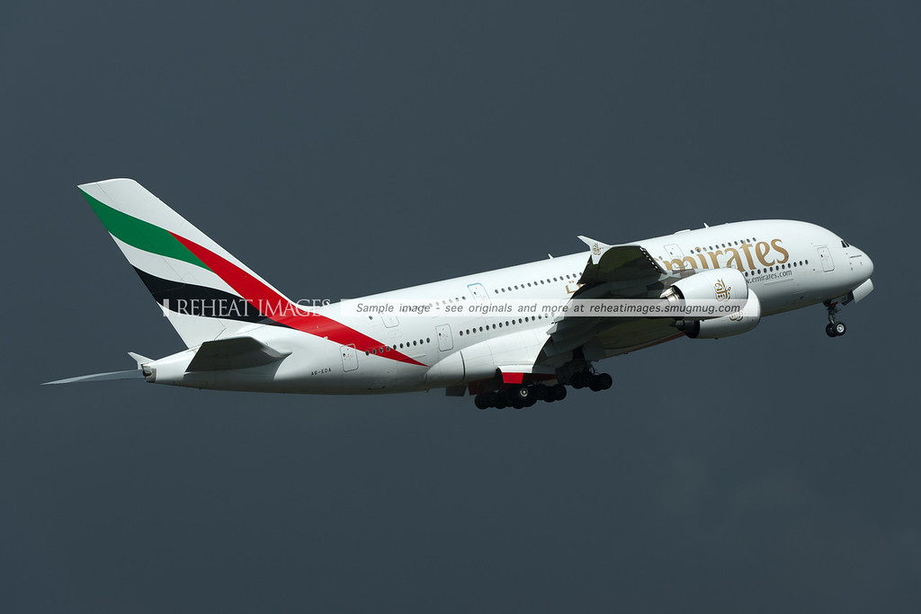 Emirates first Airbus A380 departs Sydney against the background of threatening skies.