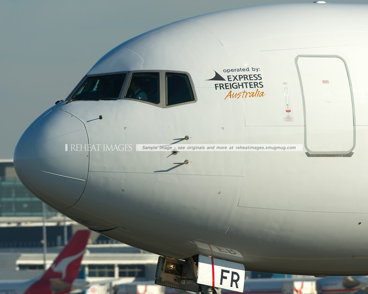A Qantas Freight (Express Freighters Australia) Boeing 767-381F/ER taxies out to runway 34 right at Sydney airport.