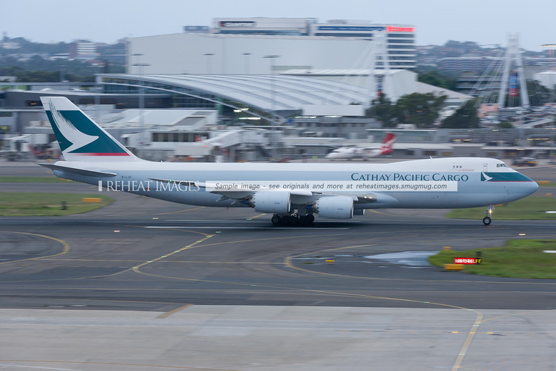Cathay Pacific B747-867F B-LJE takes off from Sydney airport. The new B747-8F is exceptionally quiet.
