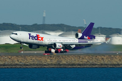 A FedEx McDonnell-Douglas (Boeing) MD-11F lands at Sydney.