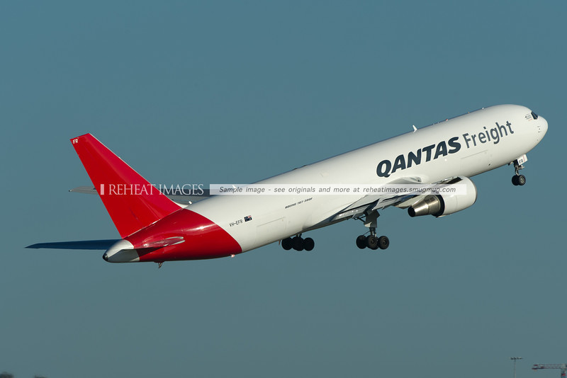 A Qantas Freight (Express Freighters Australia) Boeing 767-381F/ER takes off from runway 34 right at Sydney airport.