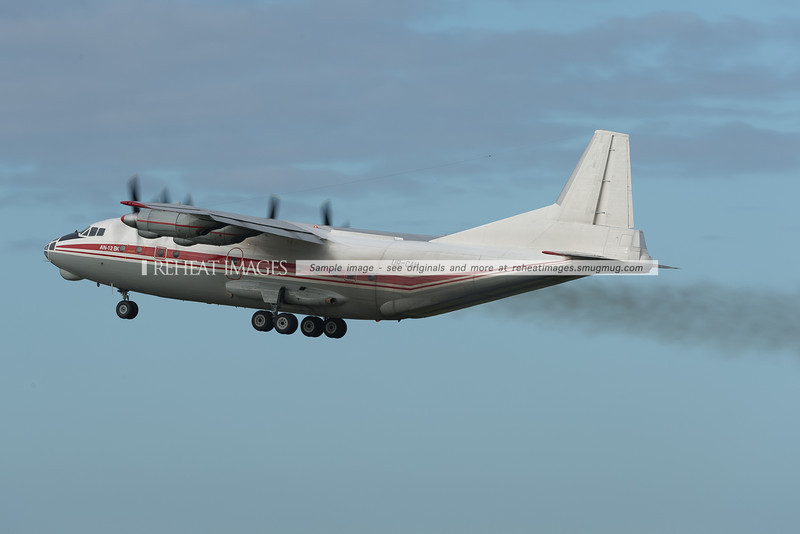 Noisy and incredibly smokey Antonov AN-12BK takes off from Sydney airport. The smoke trail is even obvious against the body of the plane itself, not just against the sky. This is a very unusual visitor.