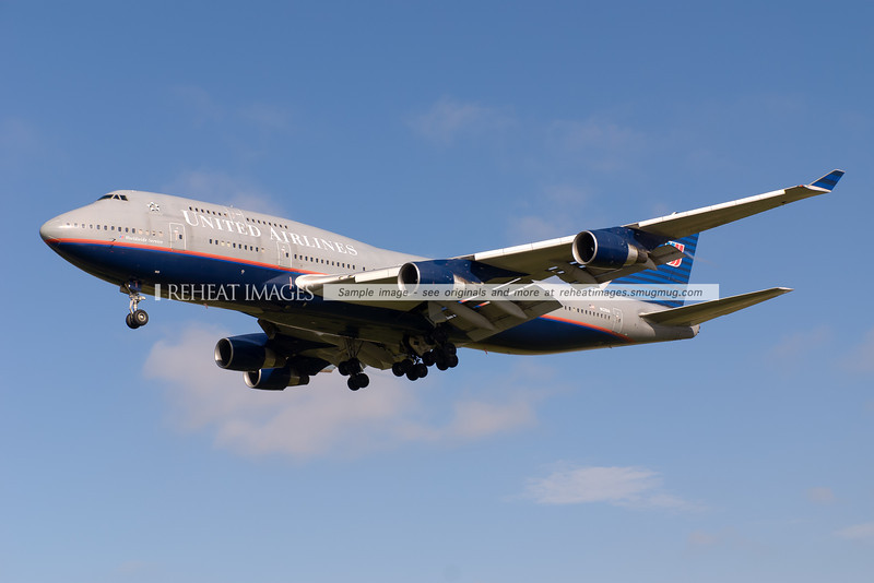 A United Airlines Boeing 747-422 approaches runway 16 right to land at Sydney airport. The plane is wearing one of the classical United Airlines colour schemes. This scheme was replaced by the blue and white scheme, and post merger with Continental Airlines, planes of the joint airline United will receive a hybrid colour scheme of the United name and Continental colours and global logo.